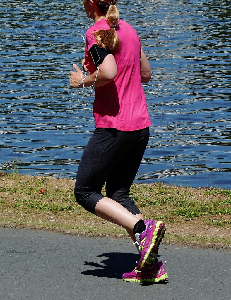 A woman is jogging outdoor.