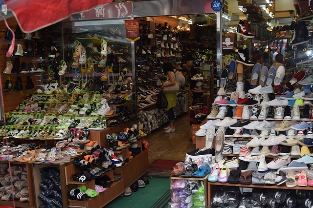 How do you find safe footwear in shoe shop displaying various types of shoes?