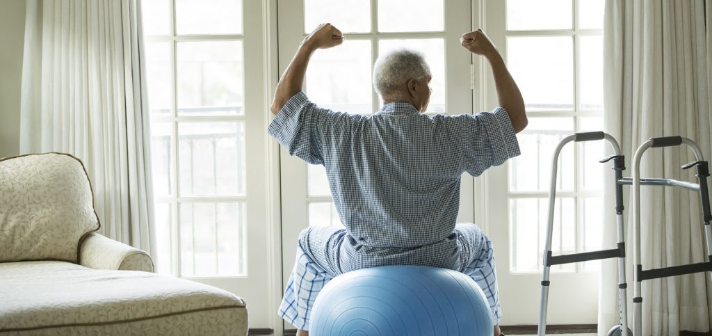 old man doing fitness exercise to prevent health risk of isolation due to covid-19 pandemic
