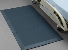 Bevelled edge floor mat placed by the bedside